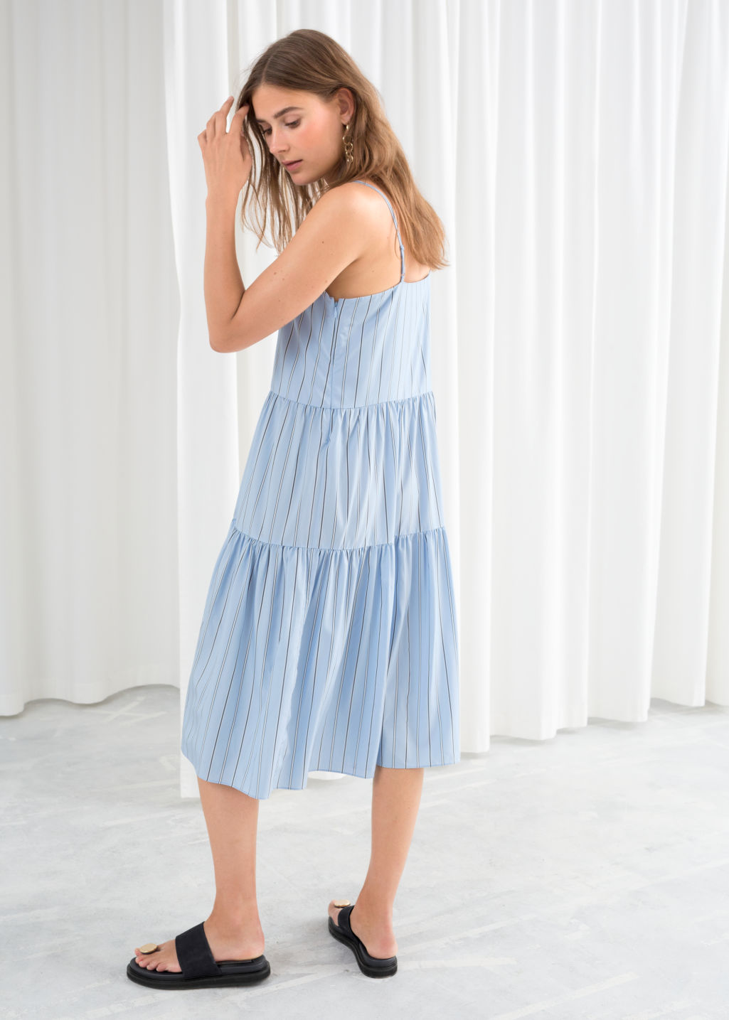 Model back image of Stories gathered pleated midi dress in blue