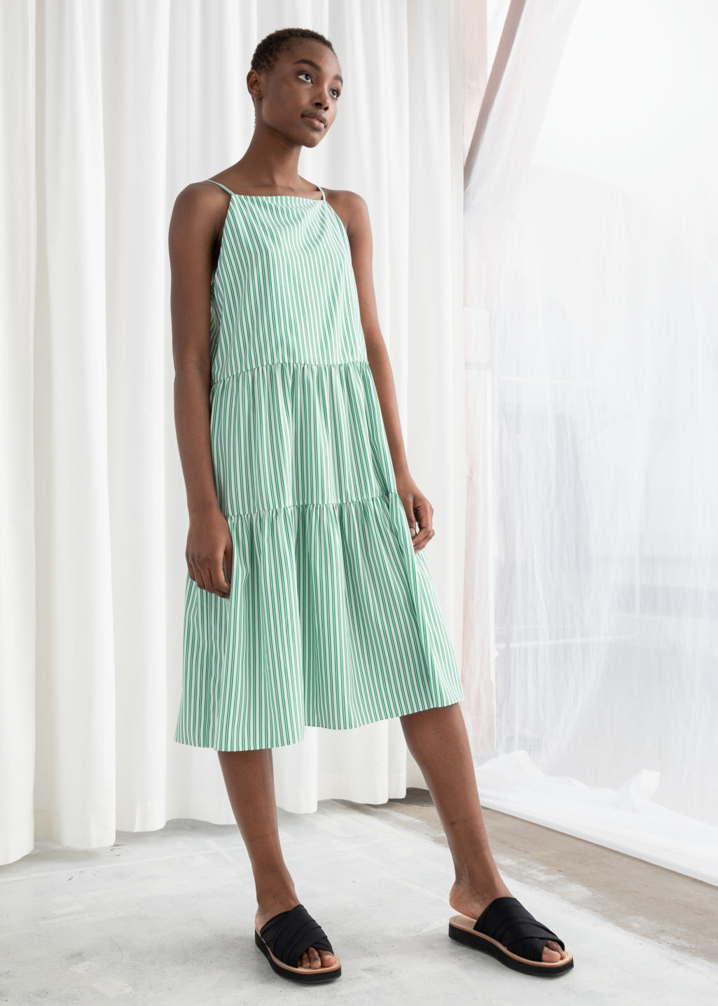 Model front image of Stories gathered pleated midi dress in green
