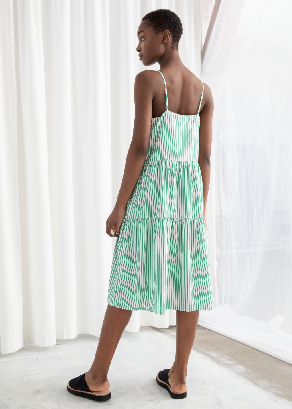 Model back image of Stories gathered pleated midi dress in green