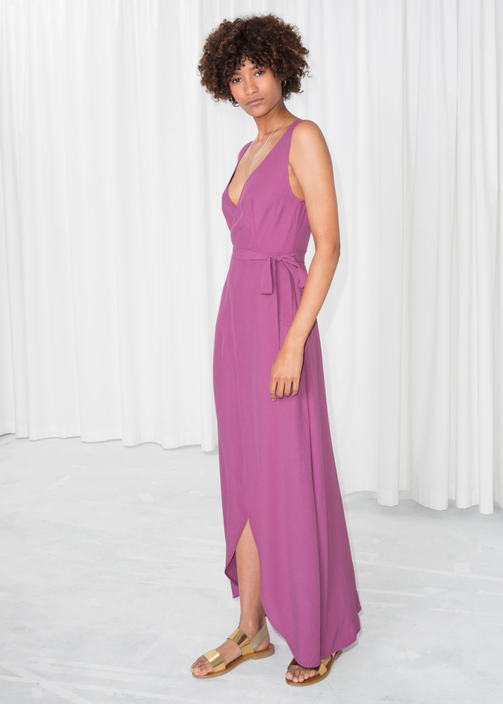 Model front image of Stories maxi wrap dress in pink