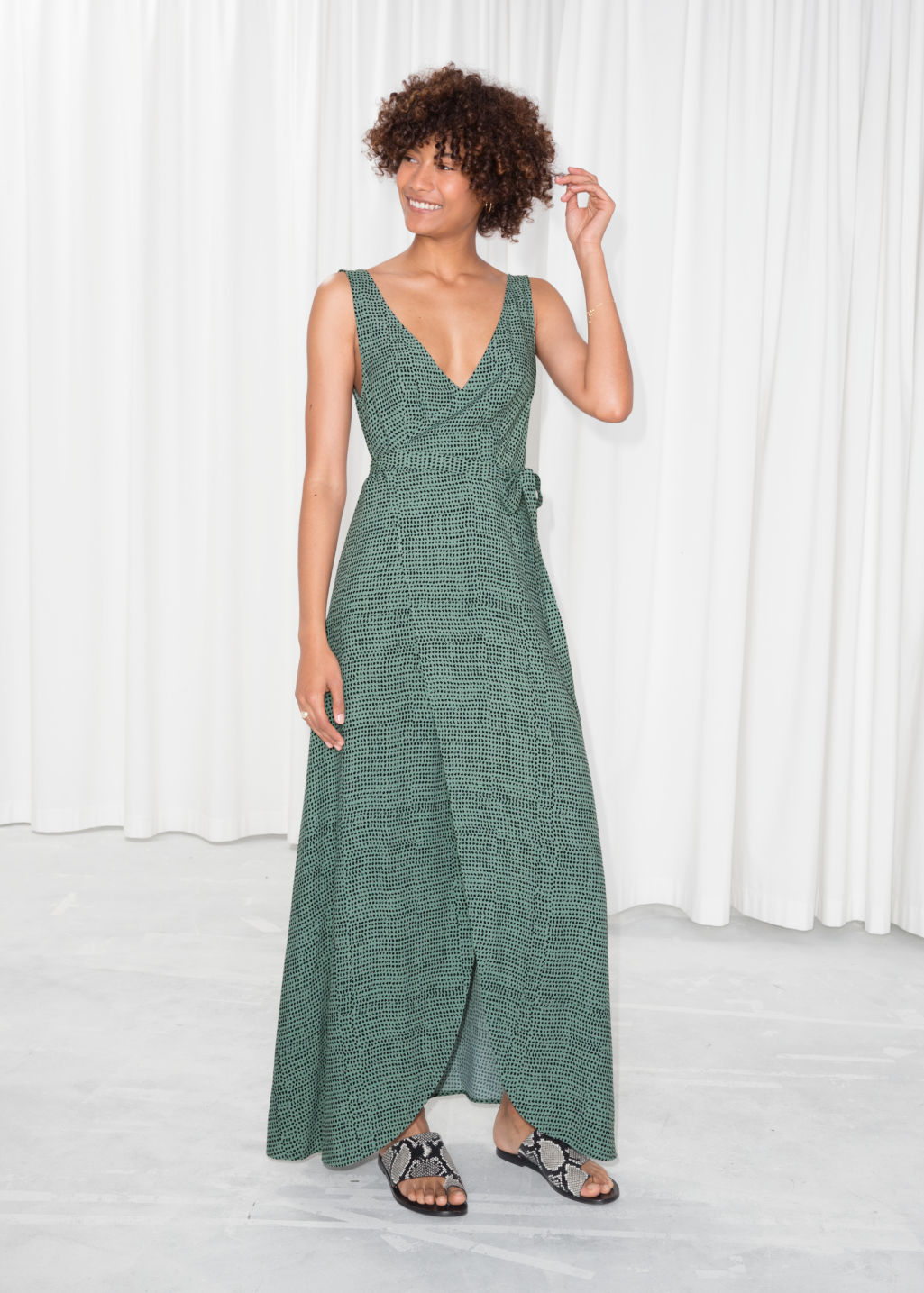 Model front image of Stories maxi wrap dress in green