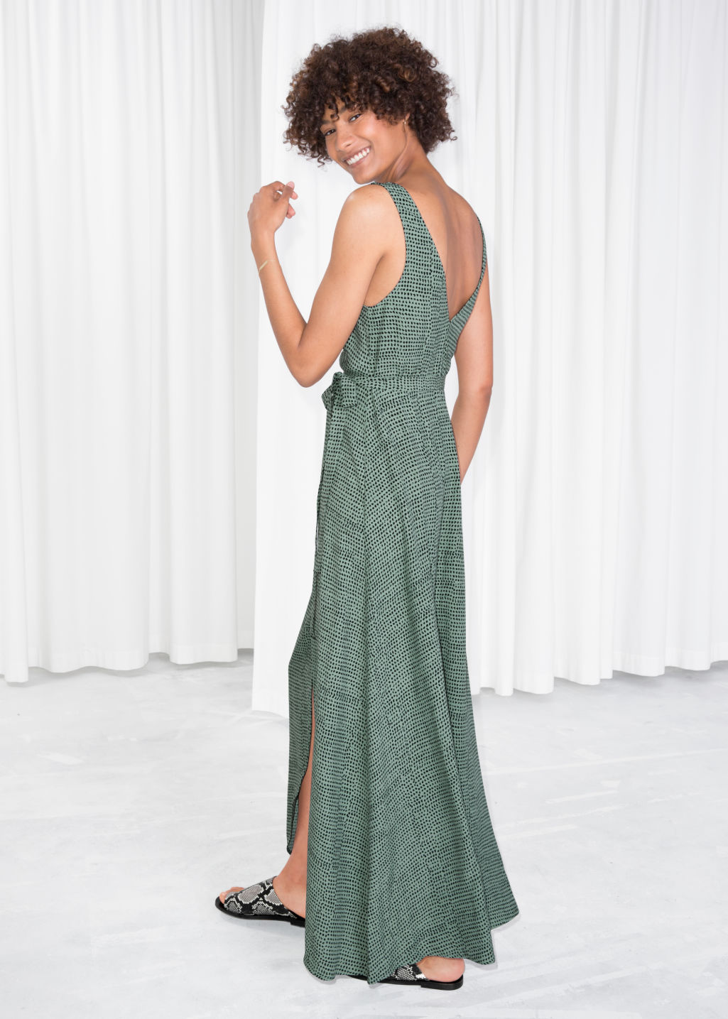 Model back image of Stories maxi wrap dress in green