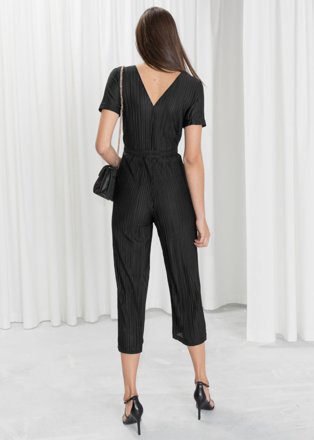 Model back image of Stories pleated wrap jumpsuit in black