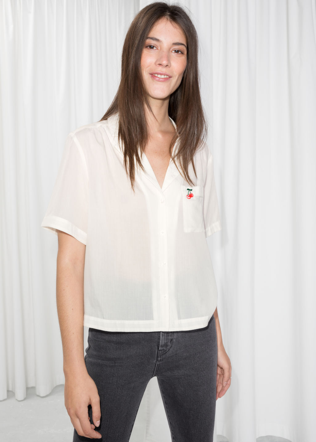 Model front image of Stories cherry patch button down  in white