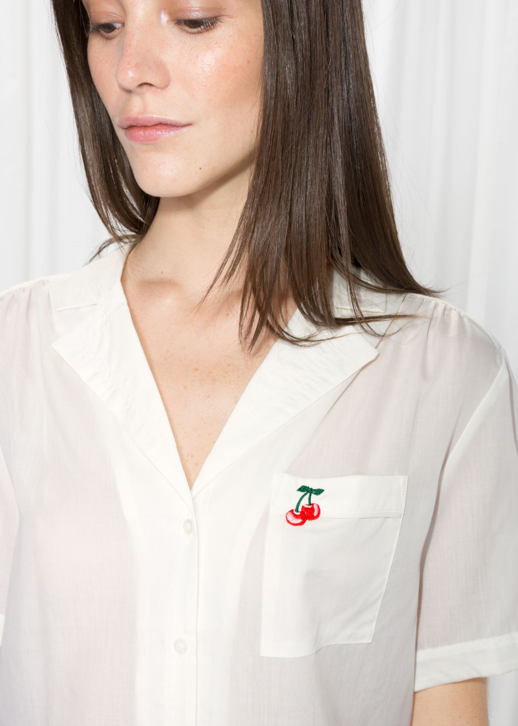Model back image of Stories cherry patch button down  in white