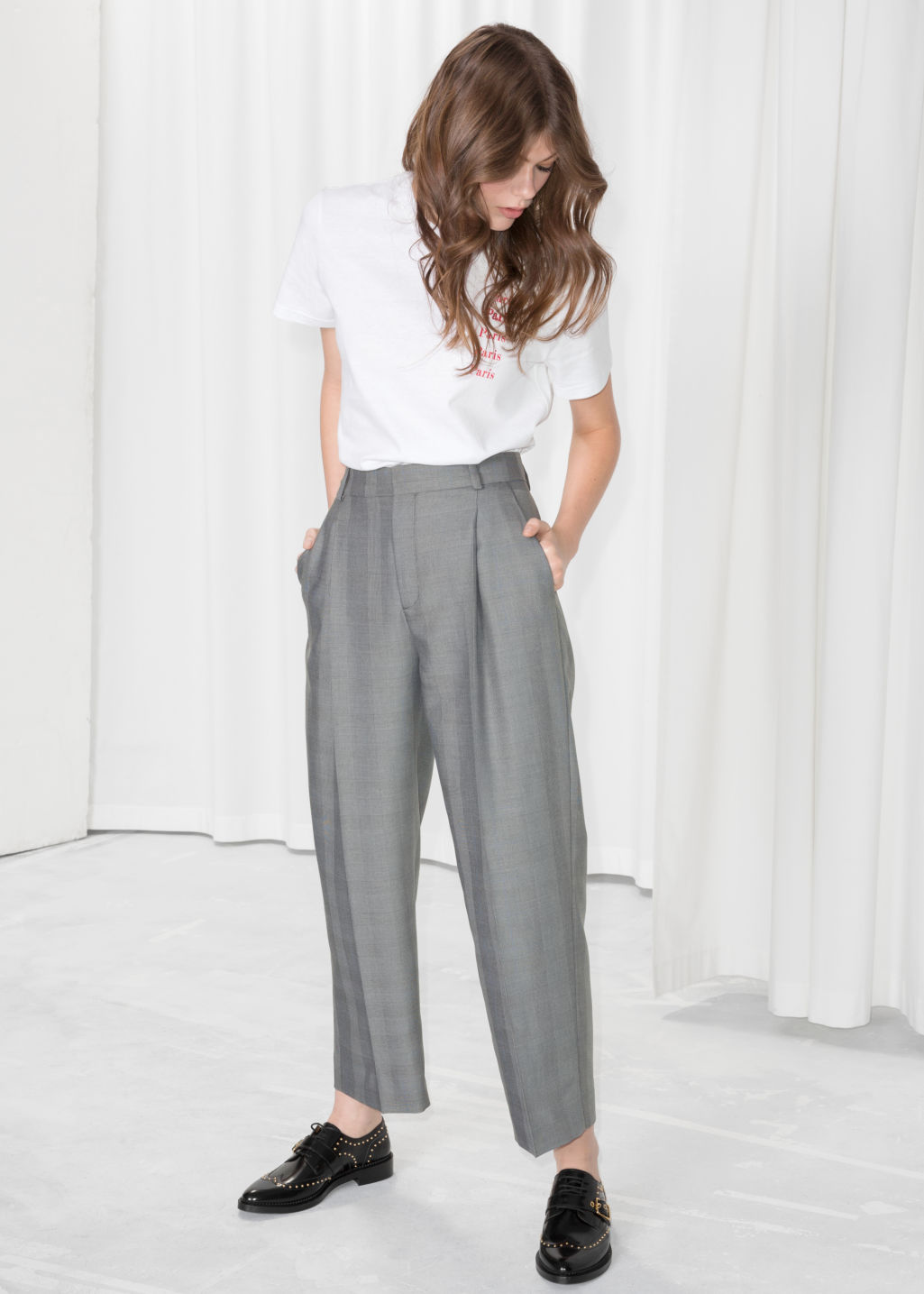 Model front image of Stories tapered plaid trousers in grey