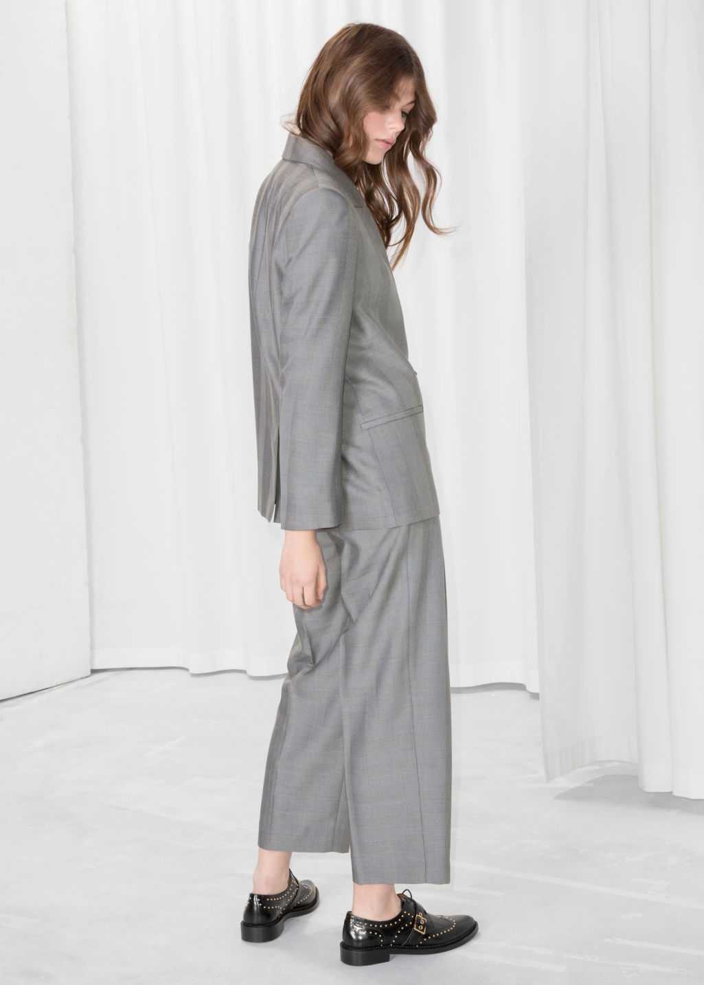 Model back image of Stories tapered plaid trousers in grey