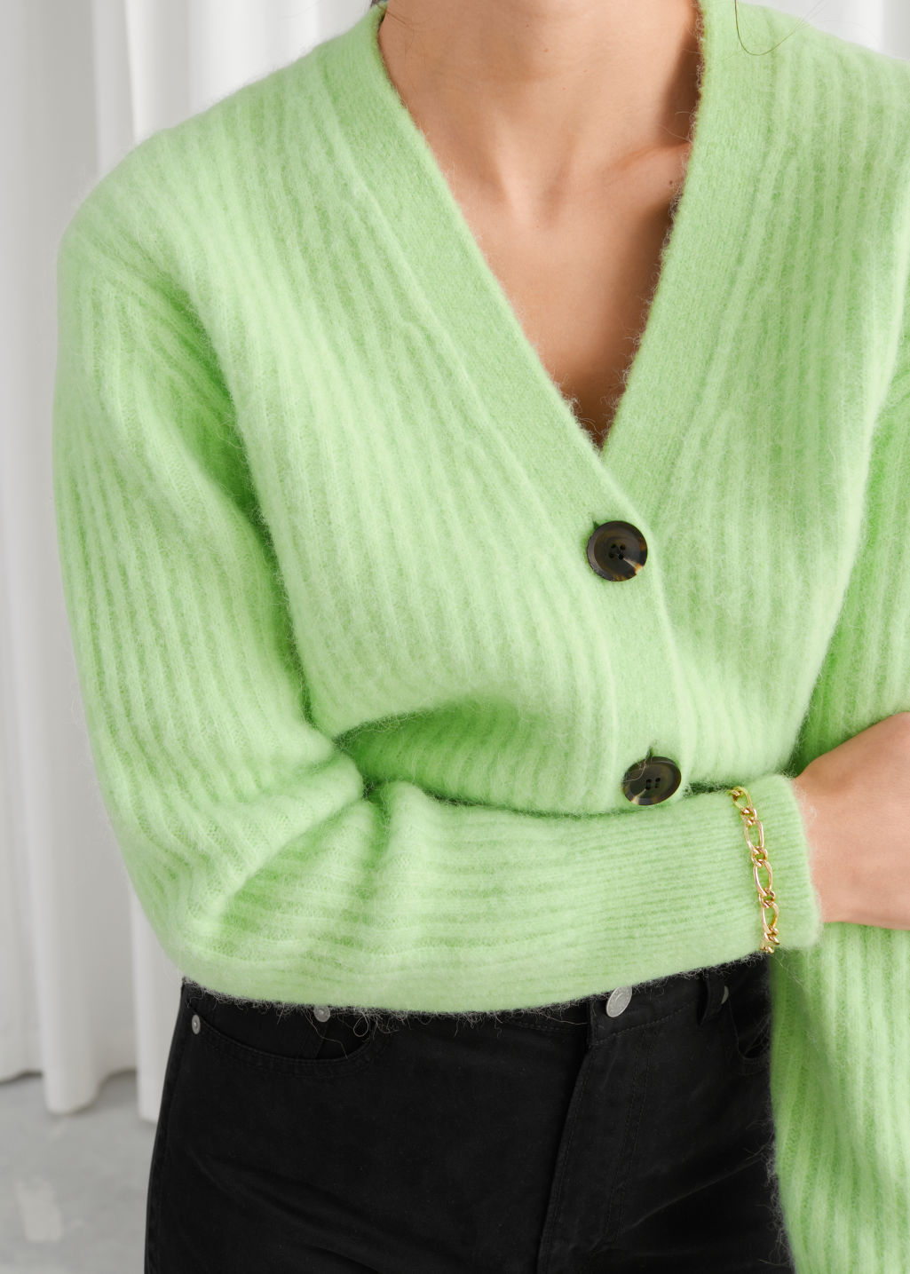 Model front image of Stories wool blend cardigan in green