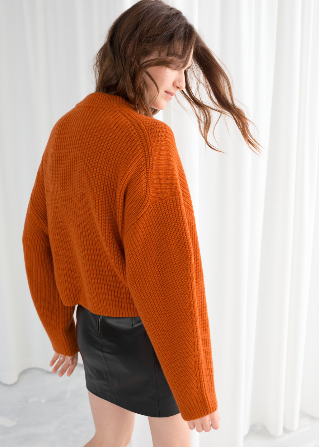 Model back image of Stories wool blend rib knit sweater in orange