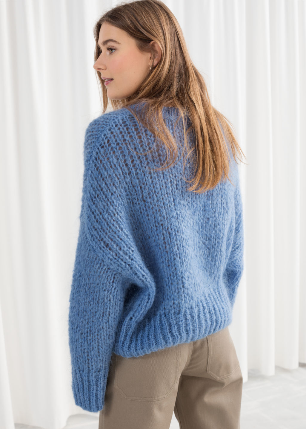 Model back image of Stories wool blend chunky knit sweater in blue
