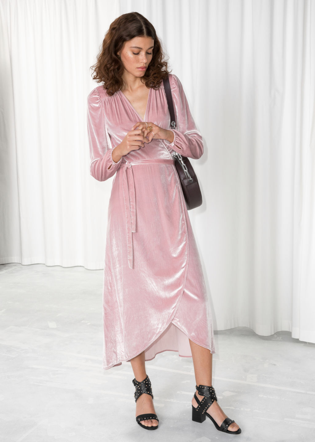 Model front image of Stories velvet wrap dress in pink