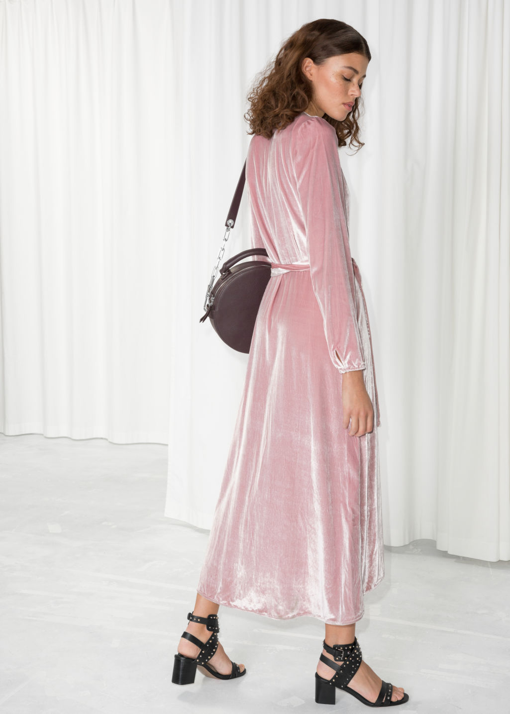 Model back image of Stories velvet wrap dress in pink