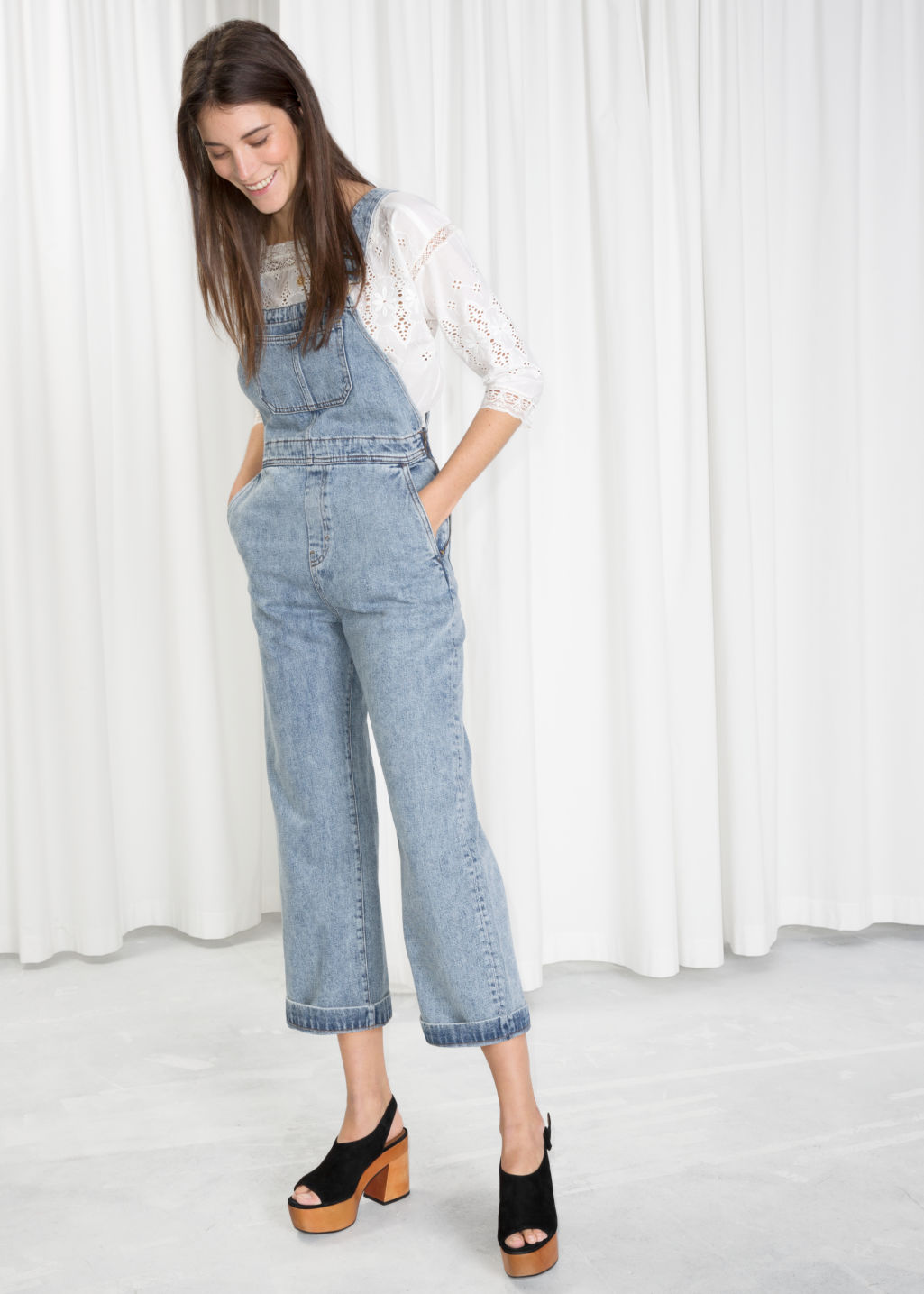 Model front image of Stories wide leg overalls in blue