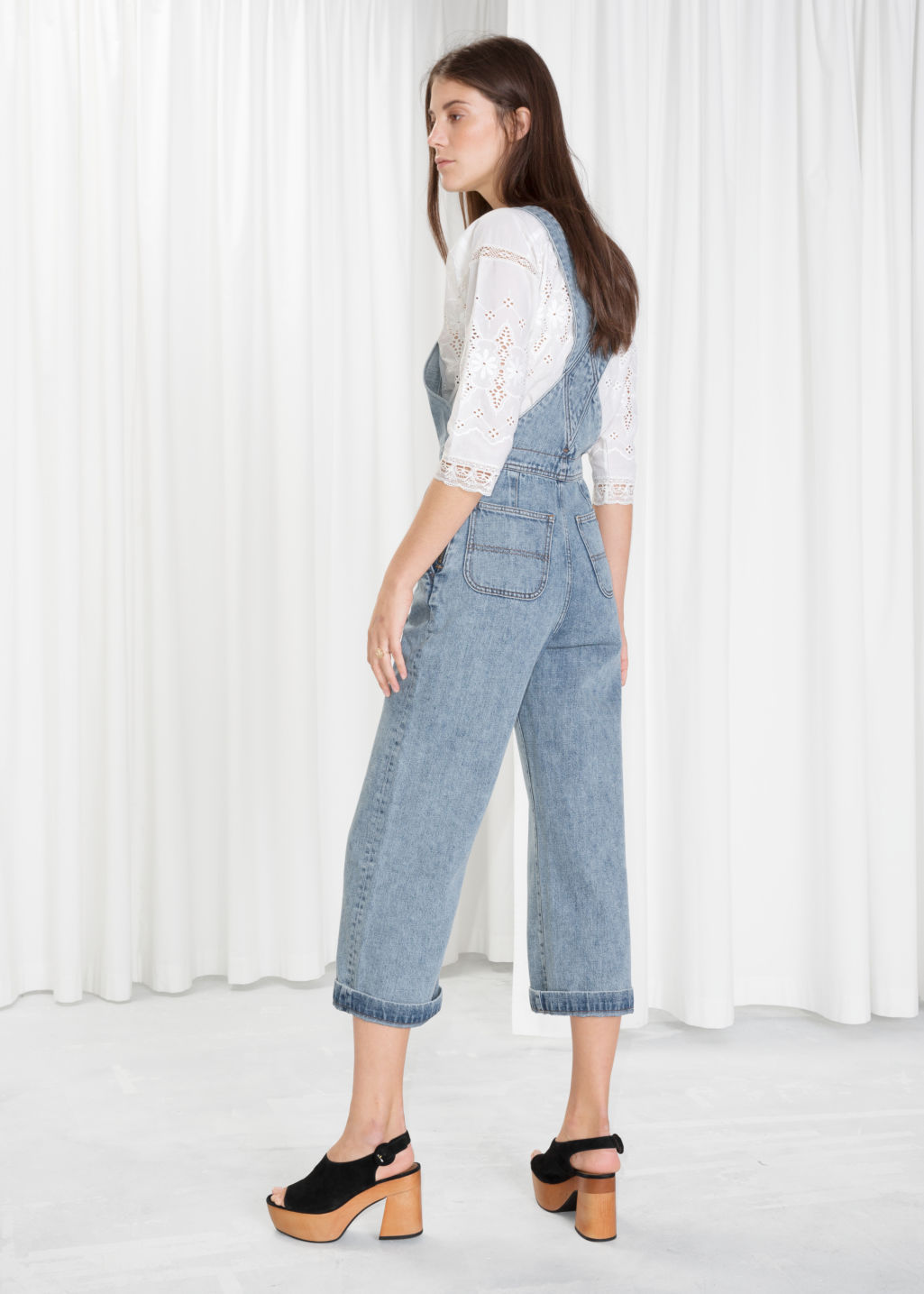 Model back image of Stories wide leg overalls in blue