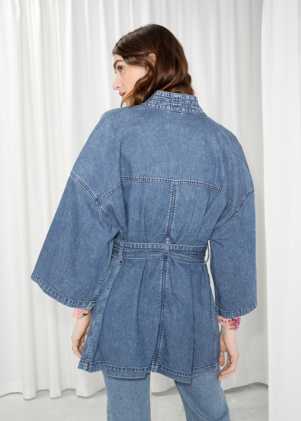 Model back image of Stories denim kimono in blue