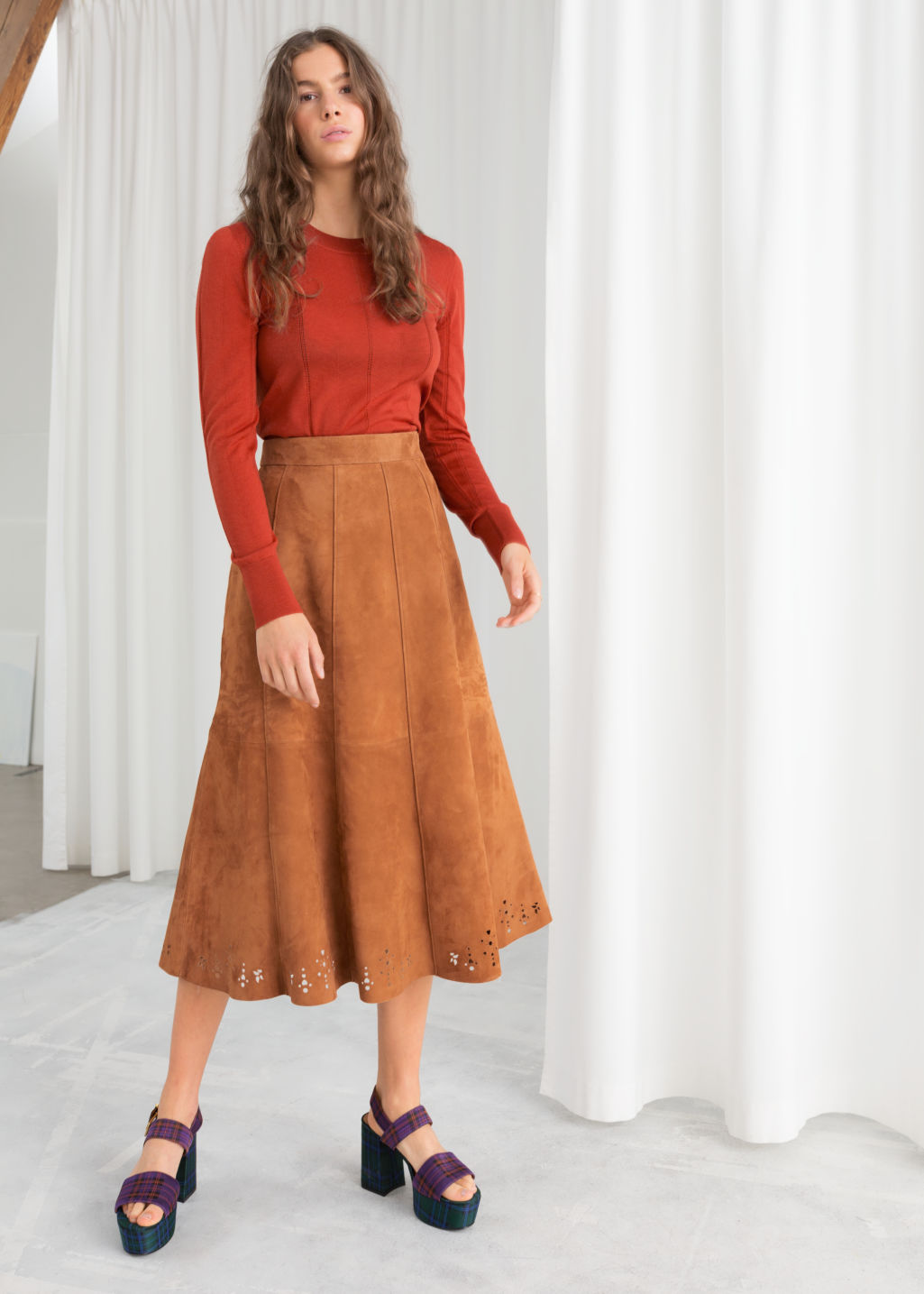 Model front image of Stories pleated suede midi skirt in yellow