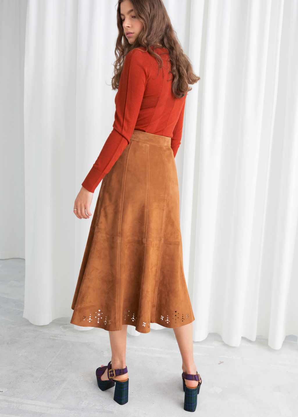 Model back image of Stories pleated suede midi skirt in yellow