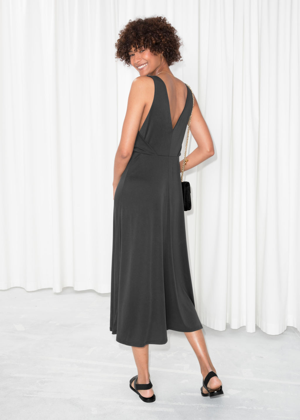 Model back image of Stories plunging midi dress in black