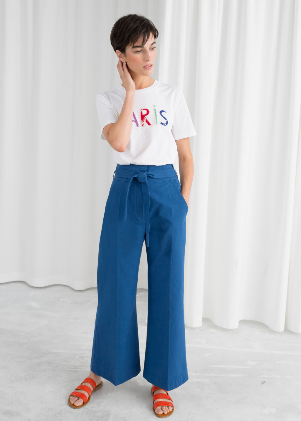 Model front image of Stories high waisted flared trousers in blue