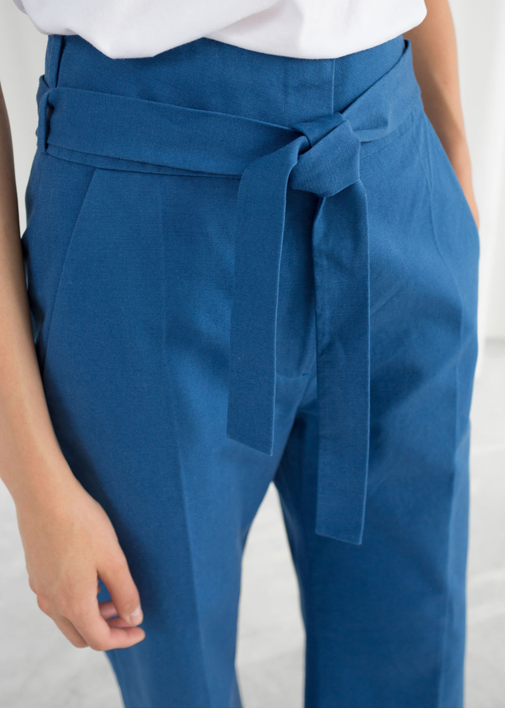 Model back image of Stories high waisted flared trousers in blue