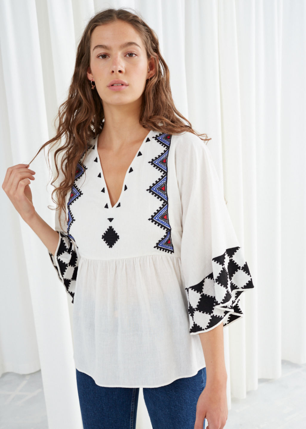 Model front image of Stories geometric peasant blouse in white