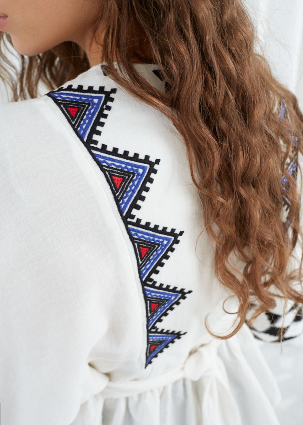 Model back image of Stories geometric peasant blouse in white