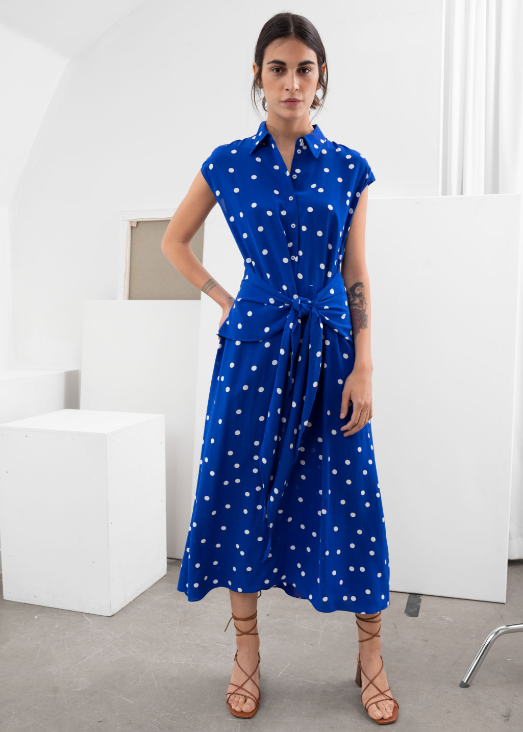 Model front image of Stories waist knot midi dress in blue