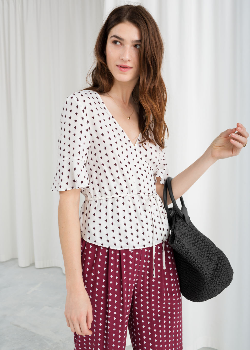 Model front image of Stories abstract spotted wrap blouse  in white