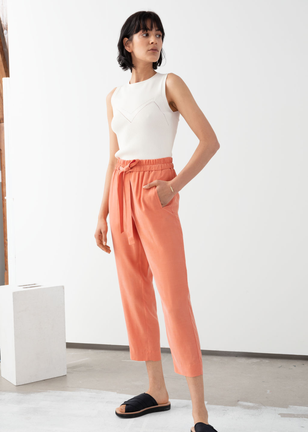 Model front image of Stories cupro blend jogger trousers in orange