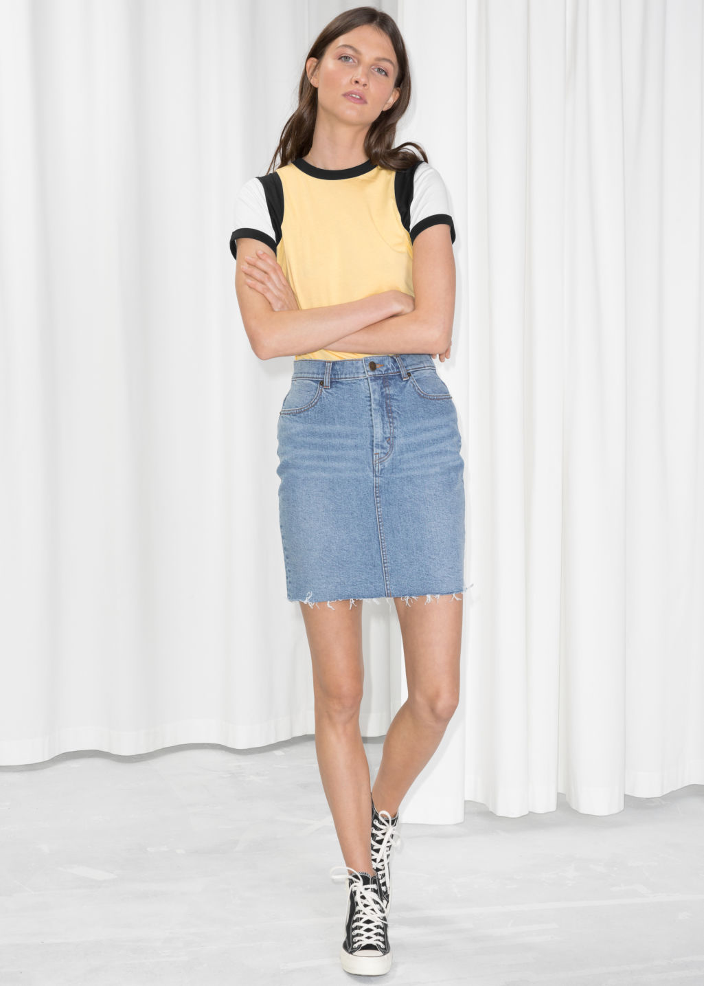 Model front image of Stories raw hem denim pencil skirt  in blue