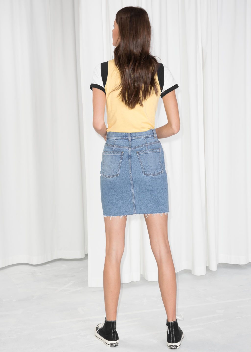 Model back image of Stories raw hem denim pencil skirt  in blue
