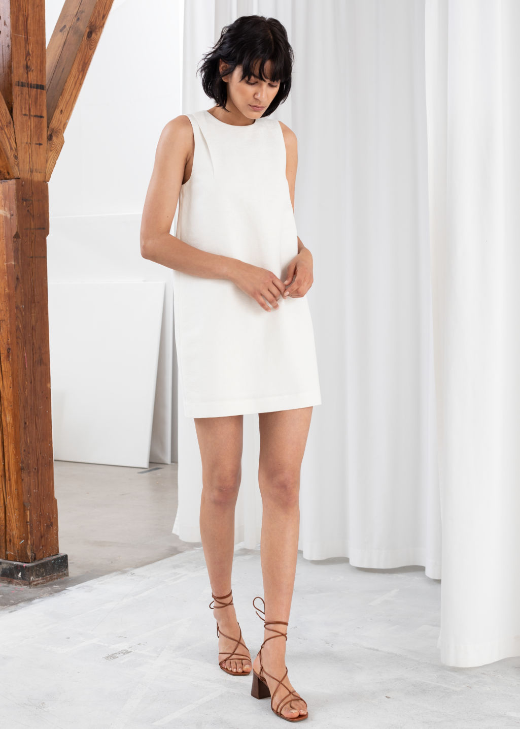 Model front image of Stories mini shift dress in white