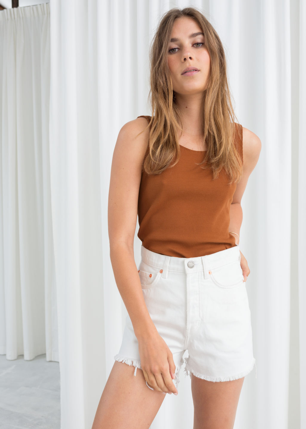 Model front image of Stories fitted scoop back tank top  in orange