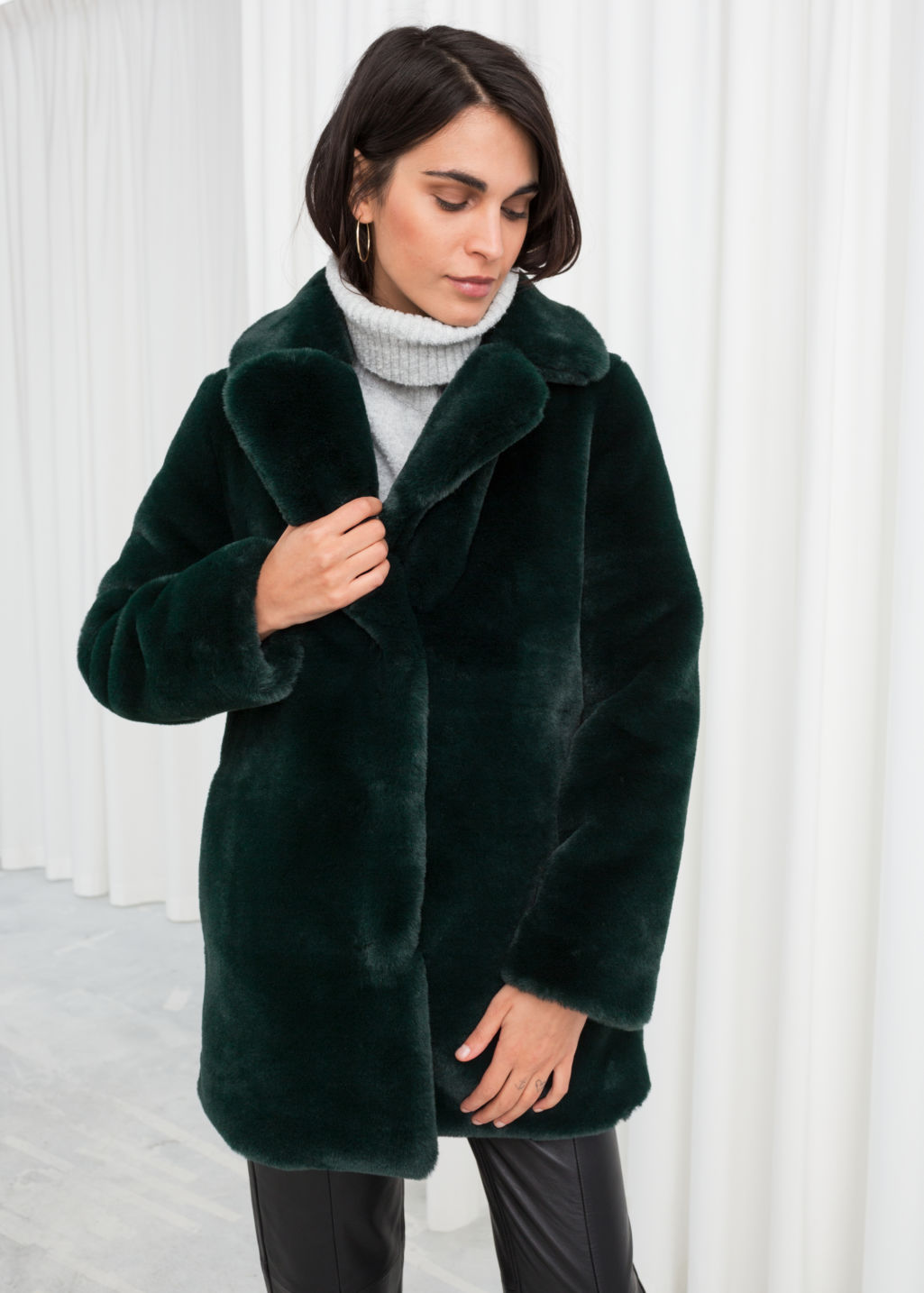 Model front image of Stories short faux fur coat in turquoise