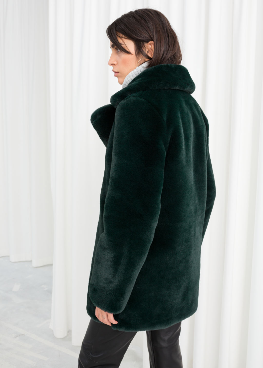 Model back image of Stories short faux fur coat in turquoise