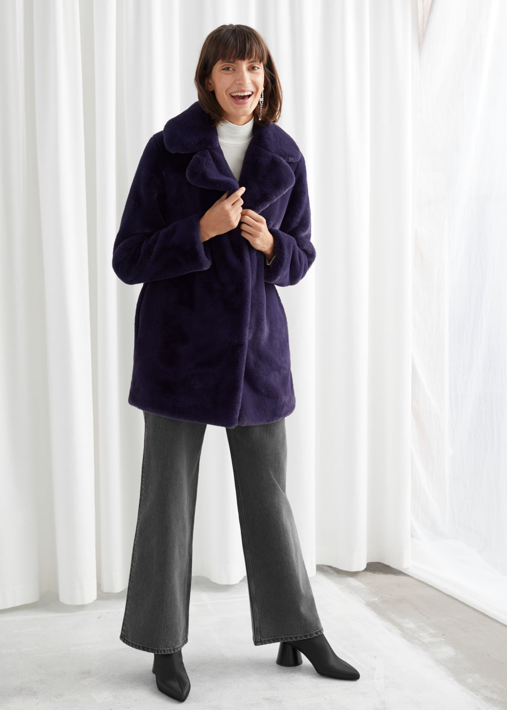 Model front image of Stories short faux fur coat in purple