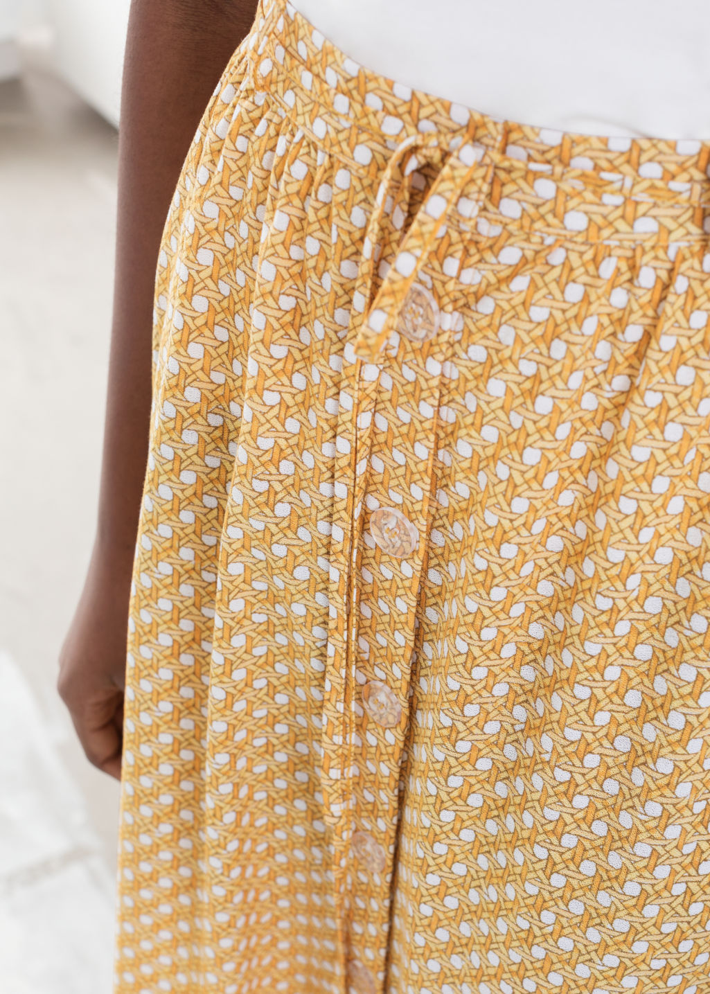 Model back image of Stories tropical print midi skirt in yellow