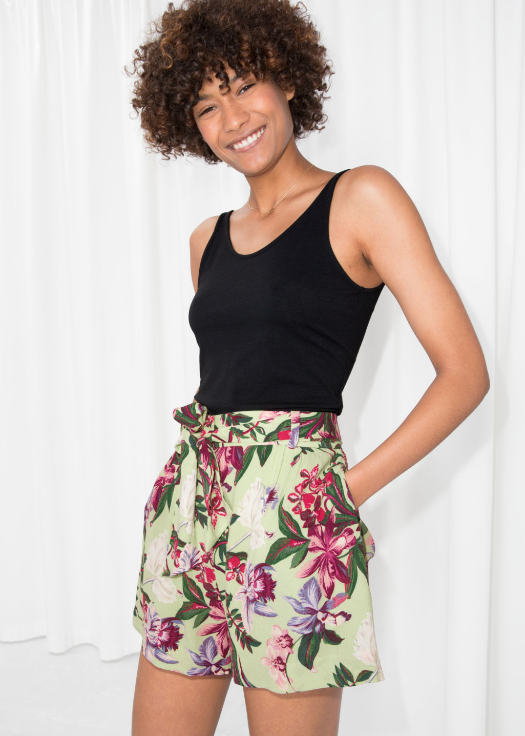 Model front image of Stories tropical print shorts in green