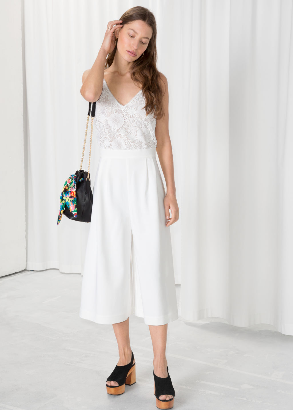 Model front image of Stories lace culotte jumpsuit  in white