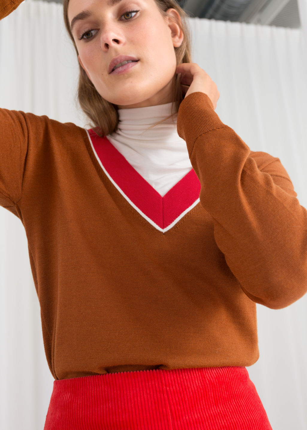 Model front image of Stories wool v-neck varsity sweater in orange