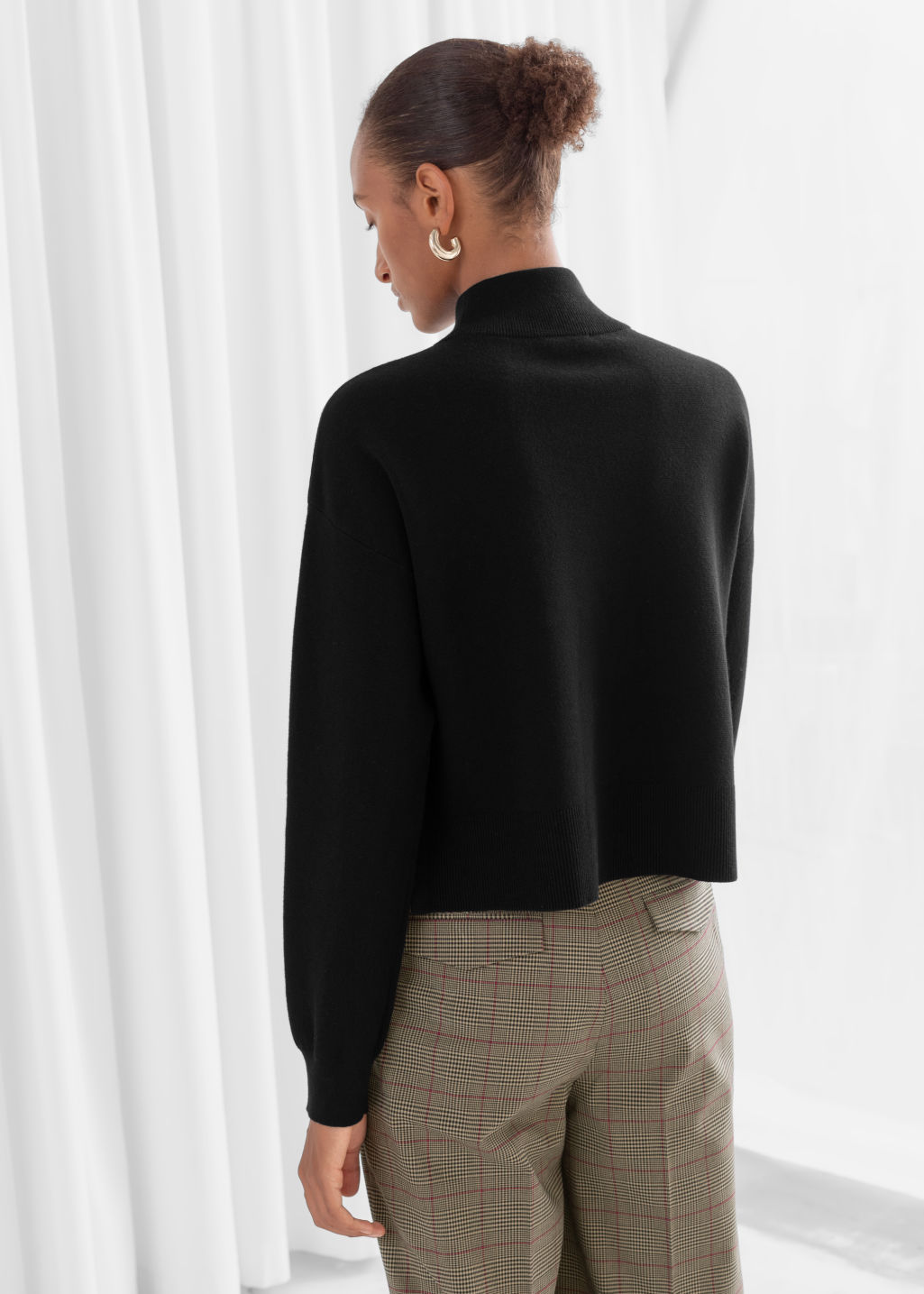 Model back image of Stories wool blend mock neck sweater in black