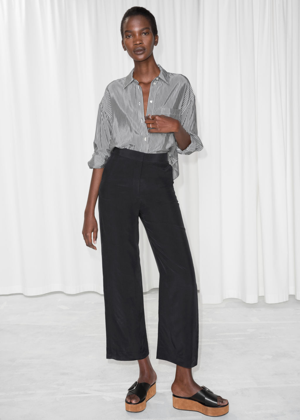Model front image of Stories straight fit trousers in black