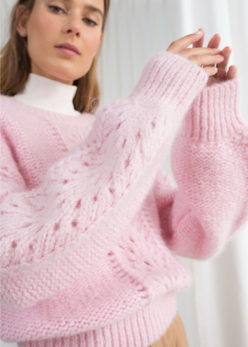 Model front image of Stories eyelet knit sweater in pink