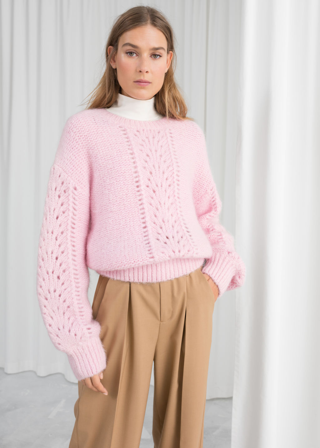 Model back image of Stories eyelet knit sweater in pink
