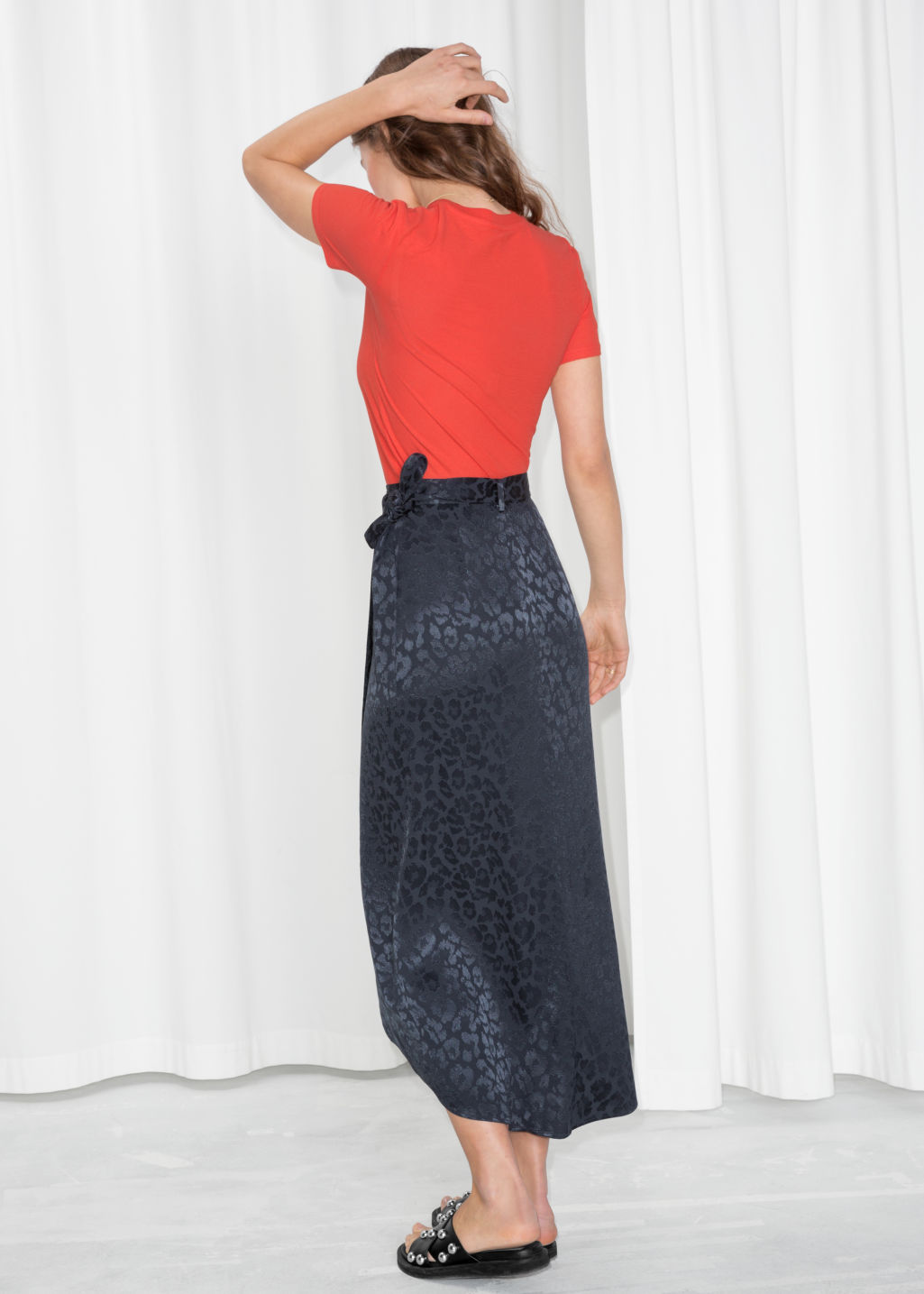Model back image of Stories jacquard leopard midi skirt  in blue