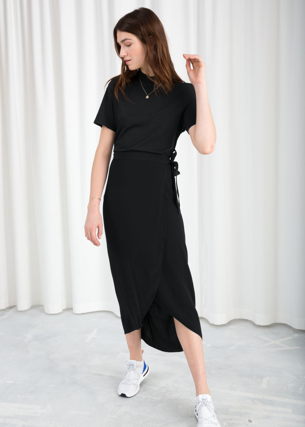 Model front image of Stories curved hem midi wrap skirt in black