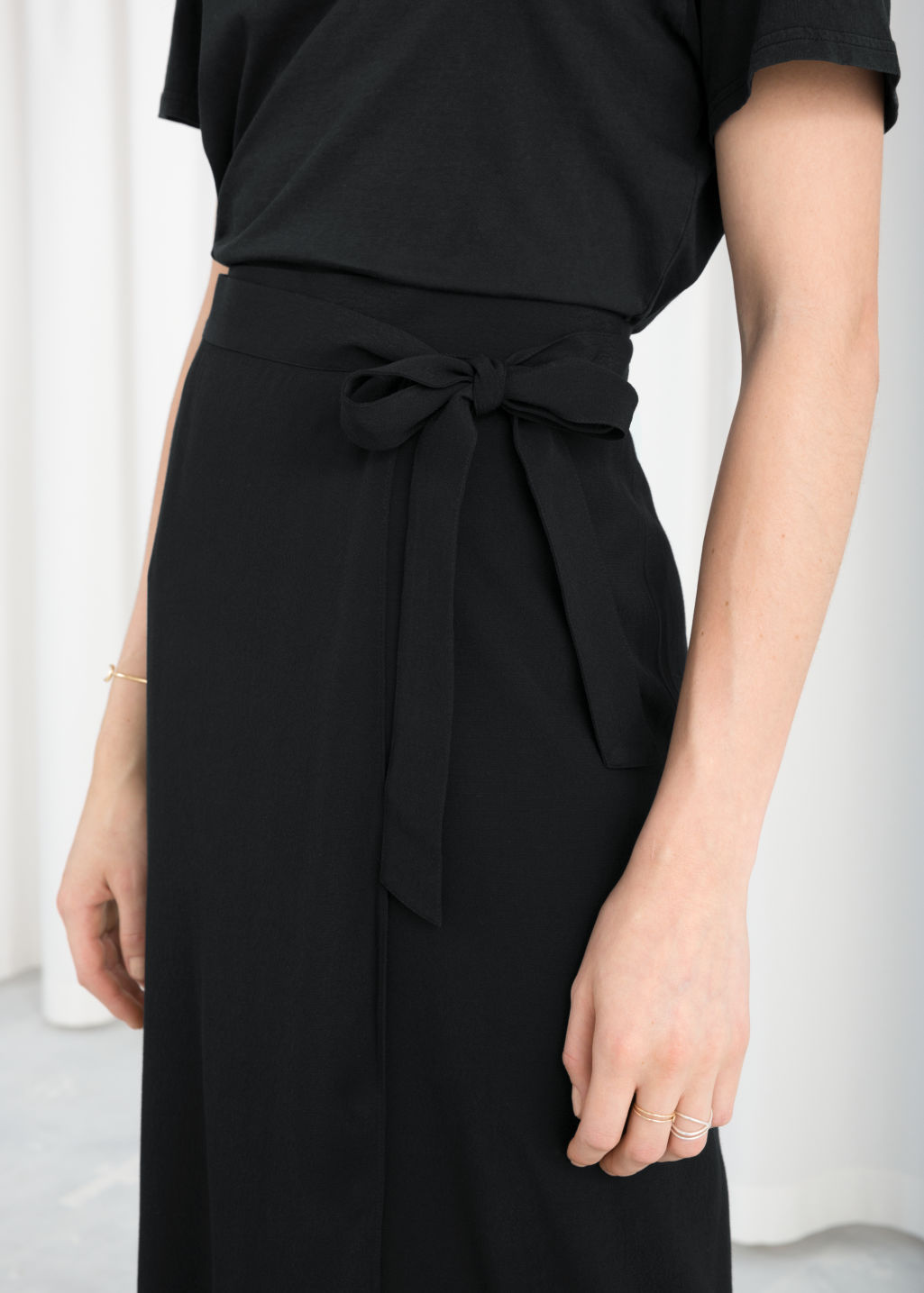 Model back image of Stories curved hem midi wrap skirt in black