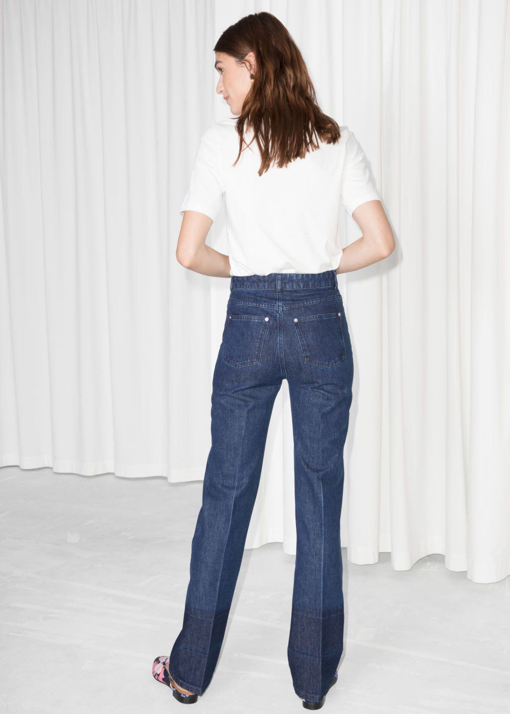Model back image of Stories high waisted flare jeans  in blue