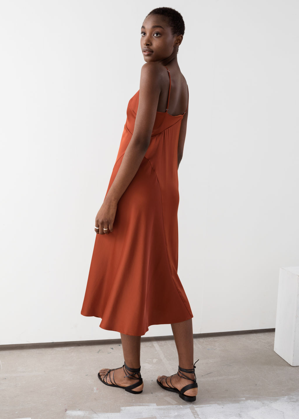 Model back image of Stories midi slip dress in orange