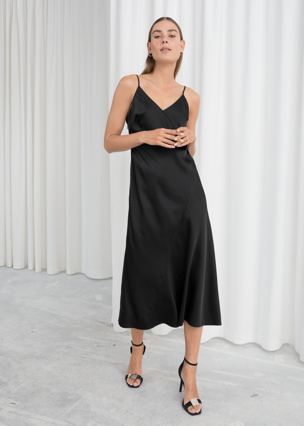 Model front image of Stories midi slip dress in black
